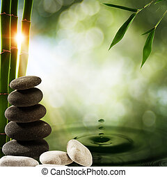 Öko-Hintergrund abbrechen mit Bambus und Wasserspritzer