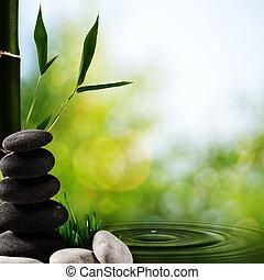 Asianischer Spa-Hintergrund mit Bambus und Kiesel