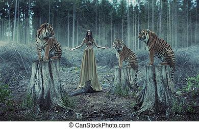 Attraktive weibliche Trainerin mit den Tigern.