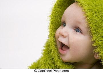 Baby in Grün