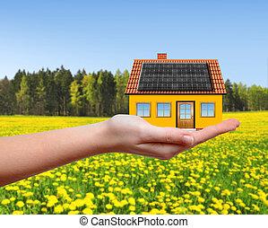 Das Haus in den Händen