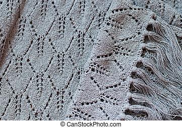 Detail aus gewebten handwerklichen Stricken grauen Pullover