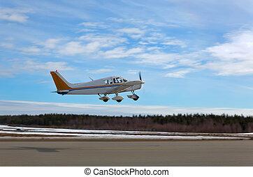 Ein kleines Flugzeug startet