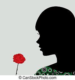 Ein Mädchen, das eine Rose riecht