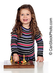 Ein reizendes Baby, das Schach spielt