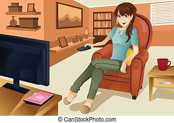 Eine Frau, die fernsieht