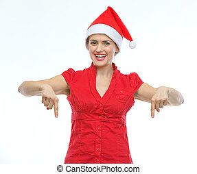 frau- zeigen, junger, unten, lächeln, hut, weihnachten