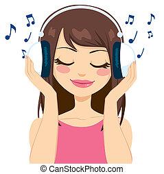 Frauen, die Musik hören.