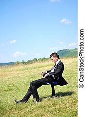 Geschäftsmann auf dem Stuhl