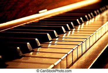 Goldene Klavierschlüssel.