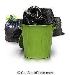 Grüne Mülltonne über einem weißen Hintergrund mit einer Plastiktüte drinnen und zwei anderen Plastiktüten an der Rückseite - Studiofoto plus 3D Müll