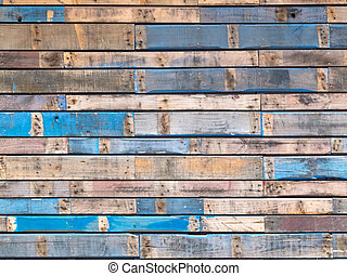 Grungy blaue bemalte Holzplanken der Außenwand.
