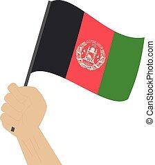 Hände halten und die nationale Flagge Afghanistans anheben.