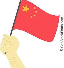 Hände halten und die nationale Flagge Chinas erheben.