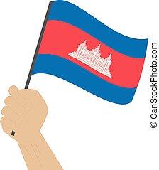 Hand halten und die nationale Flagge Kambodschas erheben.