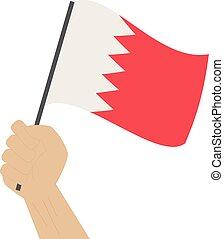 Hand halten und die nationale Flagge von Bahrain anheben.