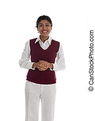 Indische Geschäftsfrau in einem Pullover.