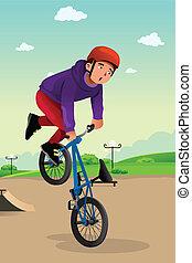 Junge macht einen Fahrrad-Stunt.