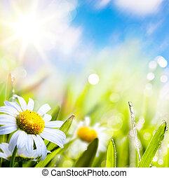 Künstliche Hintergrundblüte im Gras mit Wassertropfen am Sonnenhimmel