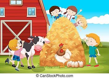 Kinder, die mit Bauerntieren spielen.