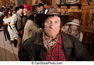 Rugged Cowboy in einem Saloon