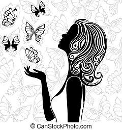 Silhouette von jungen Frauen mit fliegenden Schmetterlingen