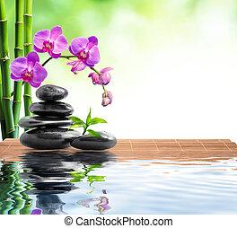 Spa Hintergrund mit Bambus, Orchidee.