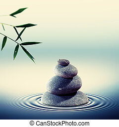 Wet pebble in the water with bamboo foliage on backgrounds, alte.