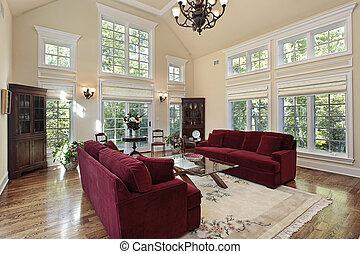 Wohnzimmer mit zwei Märchenfenstern