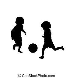 Zwei Kinder spielen Fußball.